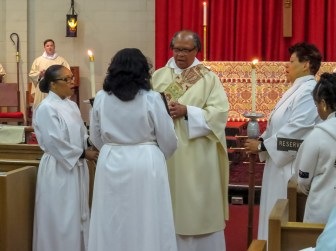 The Rev. Deacon Kevin White reads the Gospel. Supplied image.