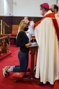 A candidate from Grace Episcopal Church is confirmed. Area Confirmations, Grace Episcopal Church, Carthage, Missouri. Image credit: Donna Field