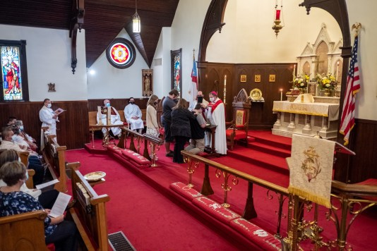 A candidate from Grace Episcopal Church is confirmed. Area Confirmations, Grace Episcopal Church, Carthage, Missouri. Image credit: Gary Allman