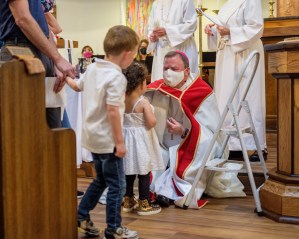 """""""You are sealed by the Holy Spirit in Baptism..."""" Baptisms at St. James Episcopal Church, Springfield, Missouri. Image credit: Gary Allman"""