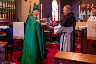 """""""James, take this water, and help me baptize in obedience to our Lord."""" The Installation of the Rev. James Harris as Priest in Charge, All Saints' Episcopal Church, West Plains, Missouri. Image credit: Gary Allman"""
