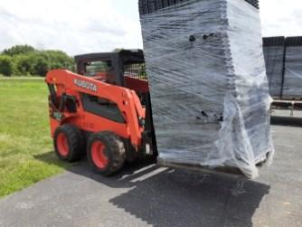 Unloading the plastic grid. Image: Chandler Jackson
