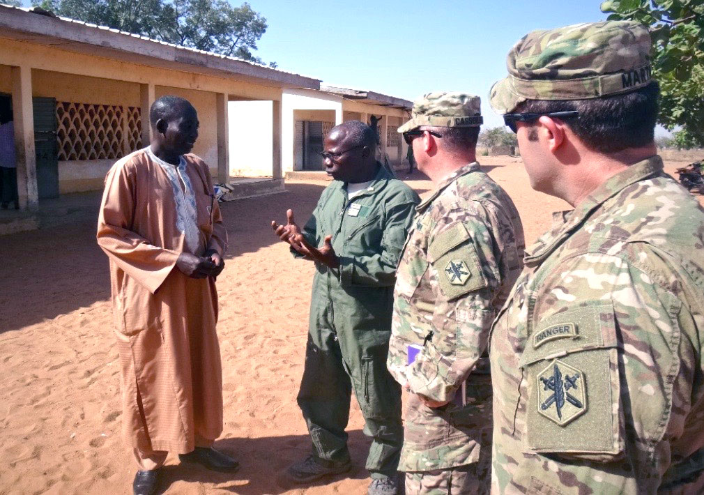 A US Civil Affairs Team, their Cameroonian Military Partner and the local Headmaster discuss the needs of the community's school and students