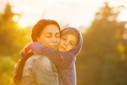 A mother and daughter hugging each other. God's Torah is about love.