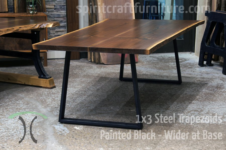 Table legs and bases for hardwood slab table tops Custom made 1 x 3 steel trapezoid legs  wider at the base  painted black