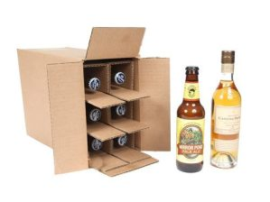 Beer bottle shipper from Spirited Shipper made for and containing six 375 bottles of beer pictured next to two bottles of beer