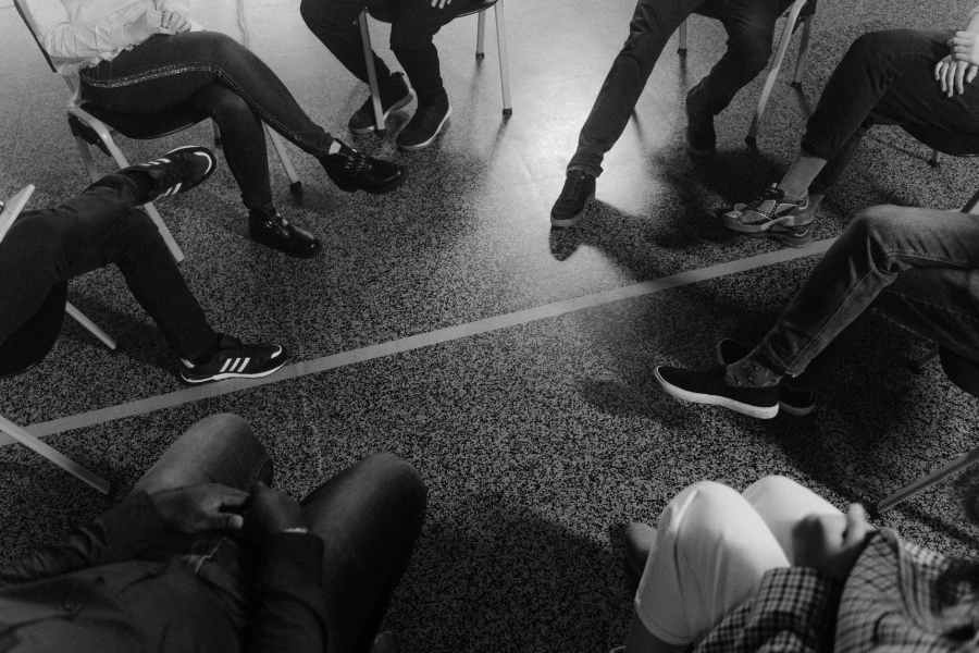 grayscale photo of people wearing shoes