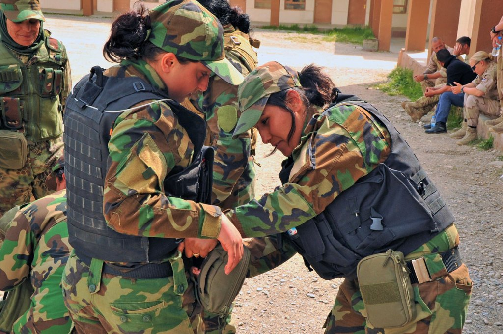 Peshmerga fighters helping to attach medical kits that were donated by Spirit of America