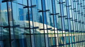 Reflection of The Shoppes on the hotel façade