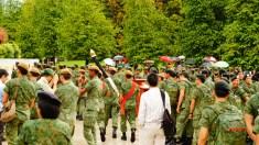 Flag bearer returning the national flag