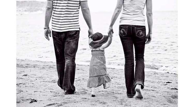 parents-child-holding-hands-beach-engagement-photography
