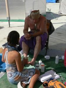 Washing feet at Burning Man 2013