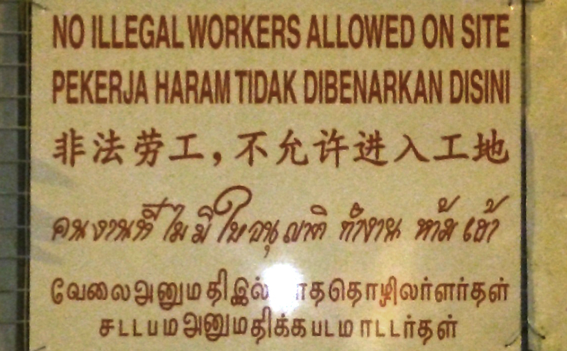 Five-language construction site sign