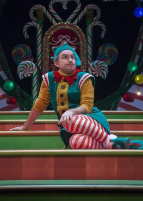 An elf looks out at the audience.