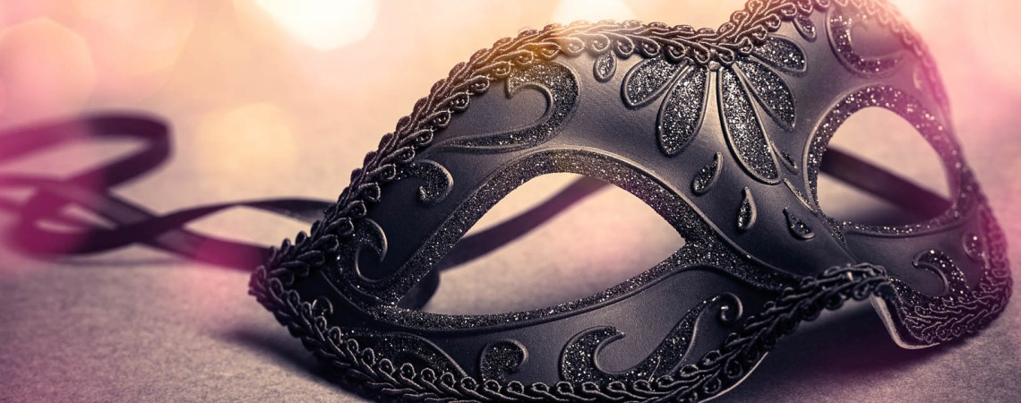 carnival mask over gold background
