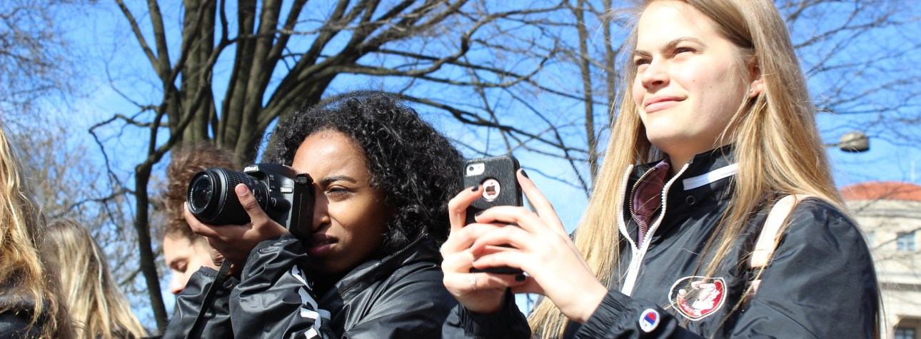 Two students taking photos