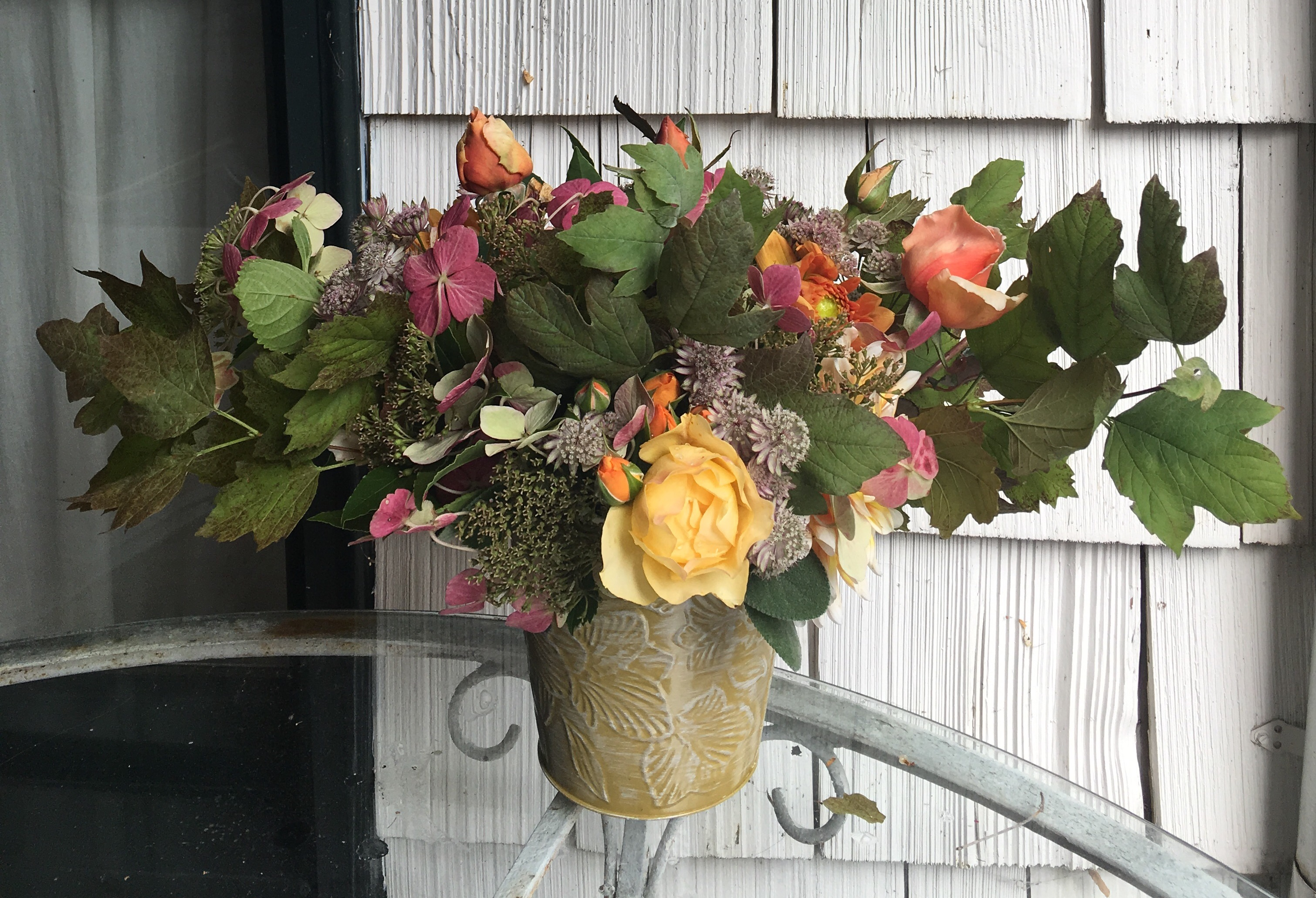 Fall bouquet, step 2: adding flowers astrantia, lacecap hydrangeas, dahlias, yellow and apricot roses.