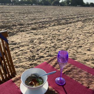 Mohinga soup and champagne in a peanut field in Myanmar, the ultimate elegant food in a rustic setting…