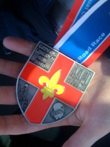 My medal - now my fourth for the Lincoln 10k :)