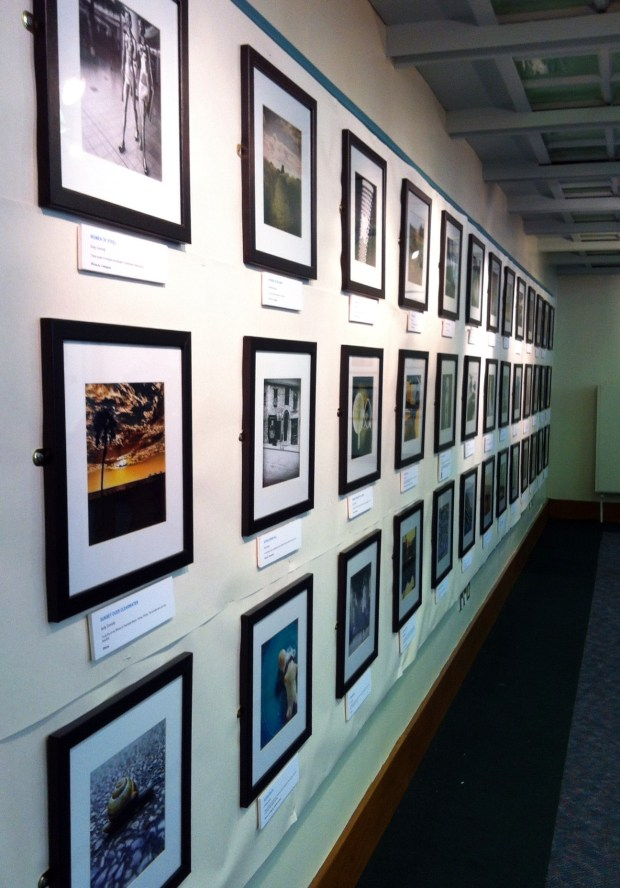 The long wall of photos