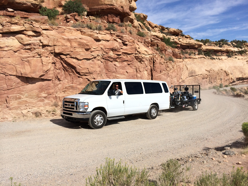 Mike in our support van arriving at the top of the dirt road we rode.