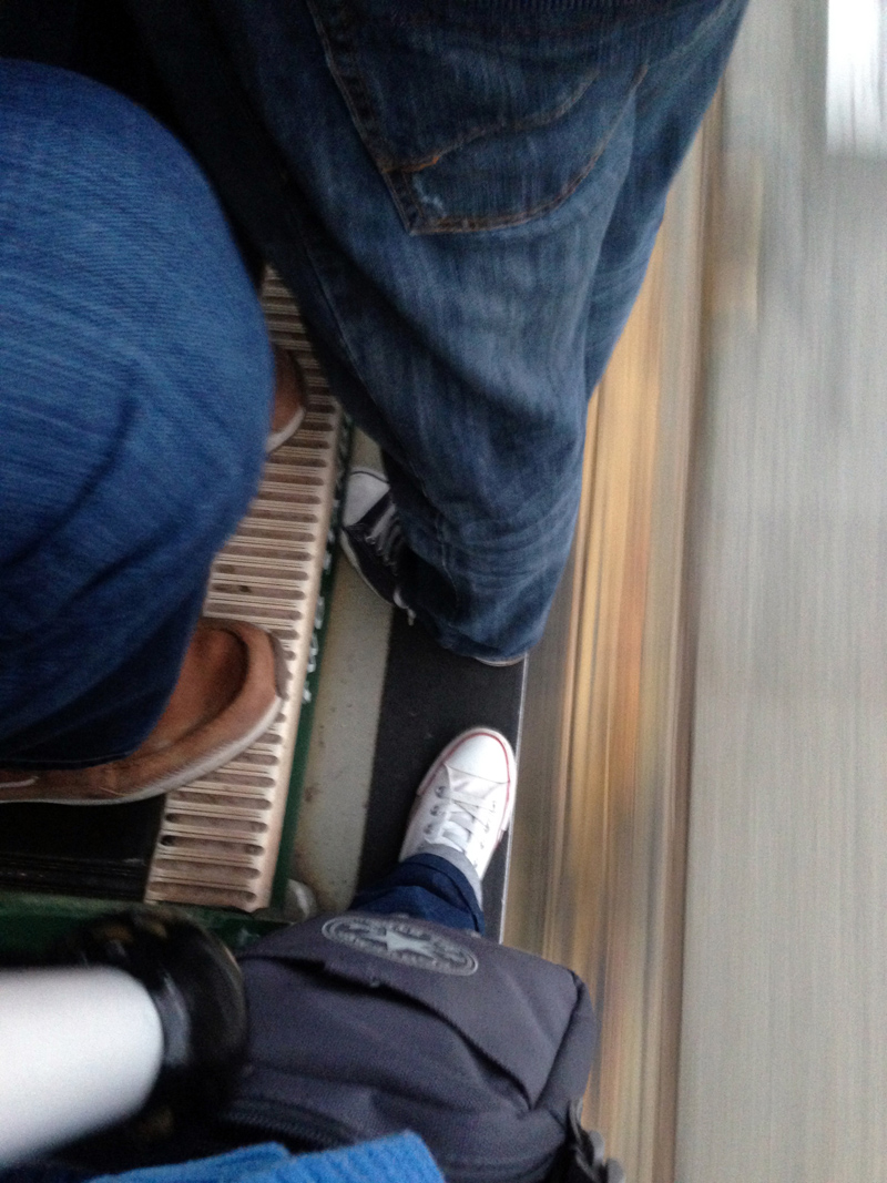 Riding on the foot plate of a San Francisco Cable Car