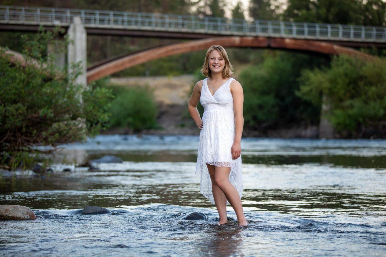 Senior photo of girl in Spokane River during senior portrait session