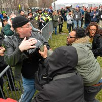 Protesters attack a man trying to pass at an entry point prior at the inauguration of President-elect Donald Trump in Washington. REUTERS/Bryan Woolston