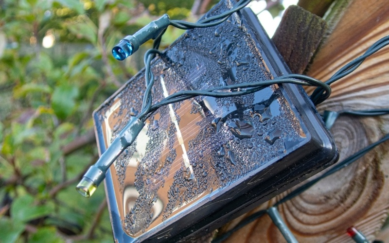 A string of solar led lights attached to a small solar panel.