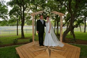 Father & daughter standing on the arch he handmade for her wedding day!