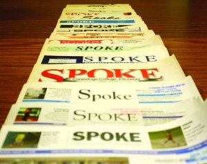 "PHOTO BY ELISSA DEN HOED Past issues of Spoke found in the LRC. Where the paper got its name is unknown. Two possibilities are that it could refer to a spoke on a Conestoga wagon, or to the paper being the ""voice of Conestoga students,"" according to an old slogan. Likely, it's both."