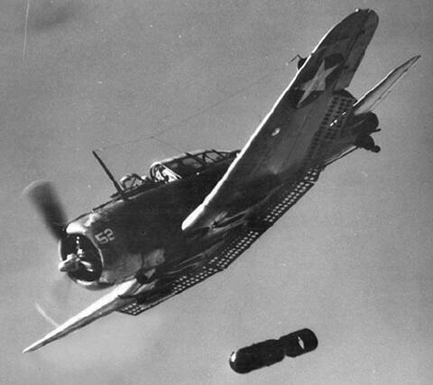 A US Navy Dauntless drops a bomb