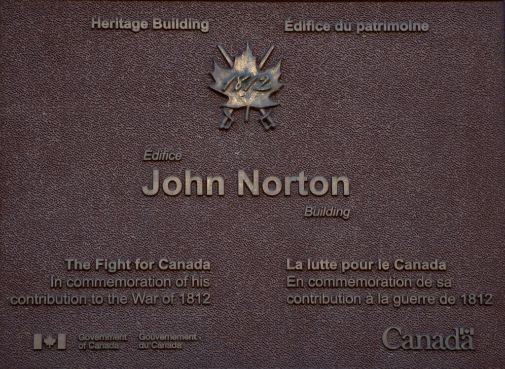 The plaque on the John Norton building.
