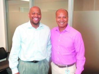 Michael Goar (r) with Michael Walker, director of MPS Office of Black Male Achievement.