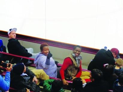 Gladys Kudzaishe Hlatywayo (right) and her husband enjoyed watching Gopher women's hockey.