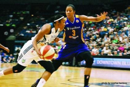 Renee Montgomery (with ball)