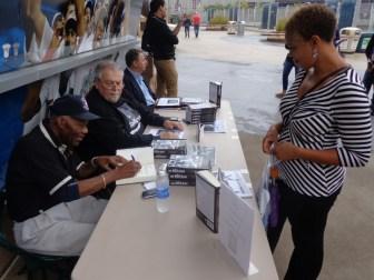 Jim Grant signing his book for Randi Chapman