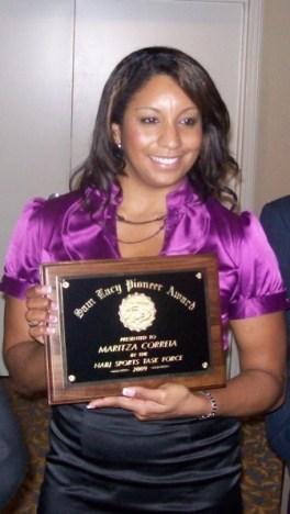 Maritza McClendon accepting her Sam Lacy Pioneer Award