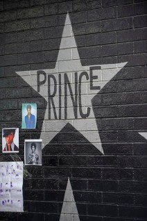 Fans paying tribute to Prince at First Avenue, featured prominently in the classic movie 'Purple Rain.'