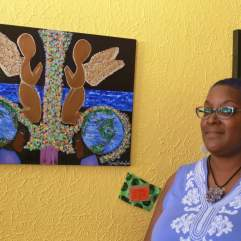 Painter, Myra Bolling-Smith, part of ROHO Collective, shows off her artwork