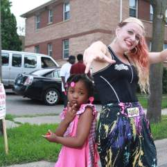 Sara Kelly, dance teacher at Hip Hope, takes a picture with a girl. Kelly reaches children through dance and music.
