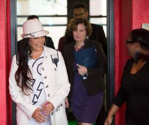 Sheila E. and Mpls Mayor Betsy Hodges entering Sabathani's Community Room