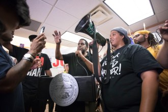 Protesters at City Hall took turns speaking at the podium after interrupting the mayor's remarks.