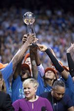 A triumphant moment as the Minnesota Lynx players celebrate their 2017 WNBA championship victory.