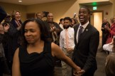 Sakeena Carter leads husband Melvin inside party for his victory speech.