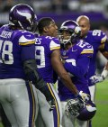 Xavier Rhodes was restrained by teammates during a heated moment during the game