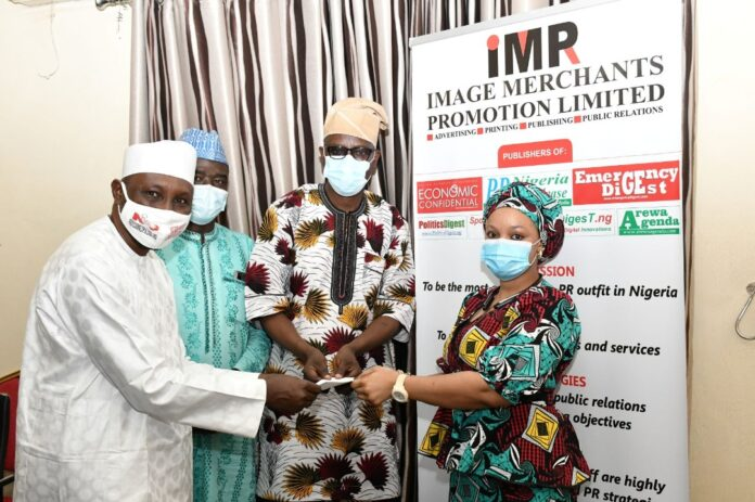 Chairman of Image Merchants Promotion, Mr Sule Yau Sule presents gift to staff at IMPR Retreat in Abuja