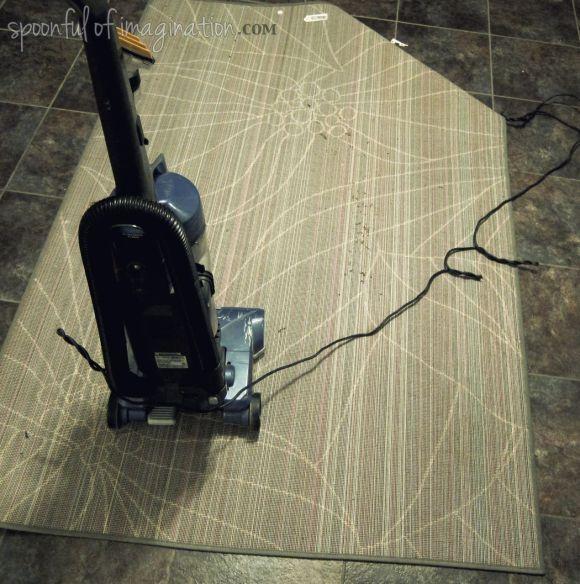 vacumming a rug