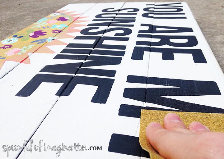 sanding_a_sign