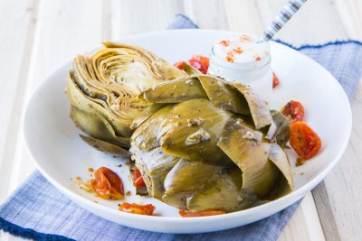 Lemony Steam-Roasted Artichokes with Garlic and Cherry Tomatoes